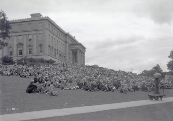 Crowd seated on the lawn of Agriculture Hall on the University of Wisconsin-Madison for a ceremony honoring S.M. Babcock, inventor of the butter test.