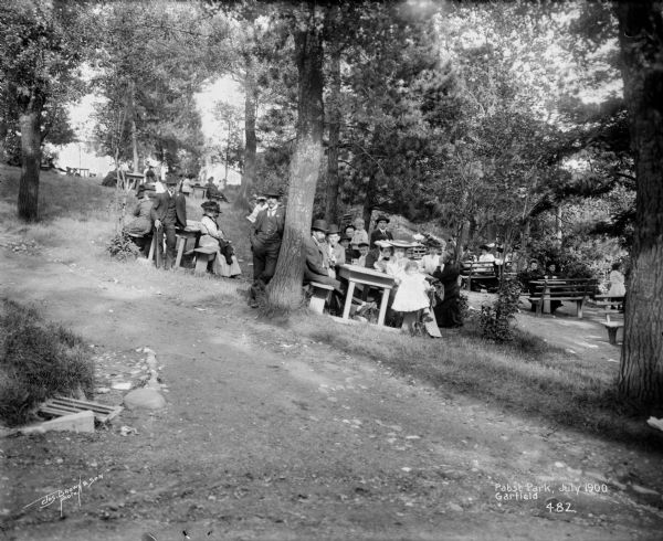 A group of people enjoy a summer day in Pabst Park beer garden at North 3rd Street and West Garfield Avenue.
