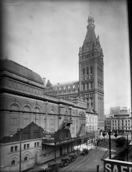 Looking northeast at the Pabst Theater and City Hall on Wells Street, east of the Milwaukee River.