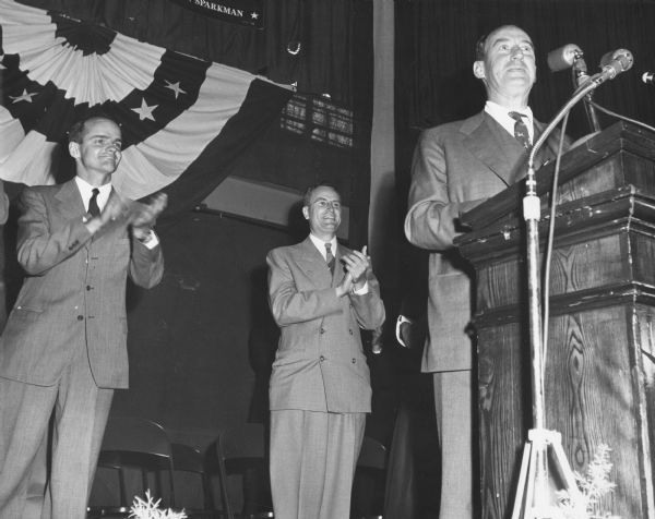 Democratic Presidential Candidate Adlai Stevenson speaking to an audience.  On the platform with him are William Proxmire, who was making the first of his three unsuccessful campaigns for governor, and Thomas Fairchild, who was running for Joseph R. McCarthy's seat in the Senate.