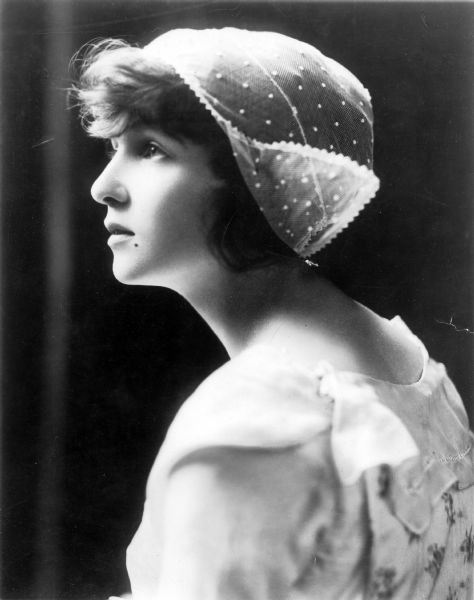 Publicity portrait of the dancer Irene Castle wearing the lace Dutch cap Vernon bought her in Brussels in 1912.