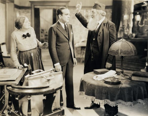 A still from the film <i>The Jazz Singer</i> showing Eugenie Besserer, Al Jolson, and Warner Oland (Warner 1927).