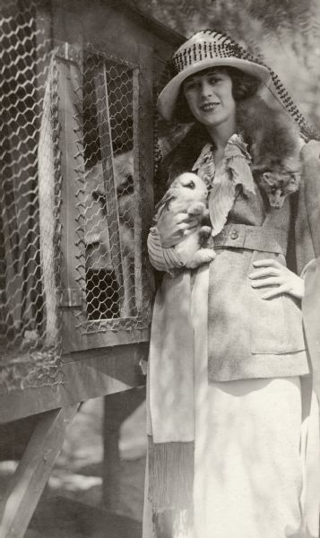 "Silent film actress Anita Stewart holds a live rabbit and wears a dead fox.  Original caption: ""Anita Stewart with her pet rabbits at her home in Hollywood, Cal."""