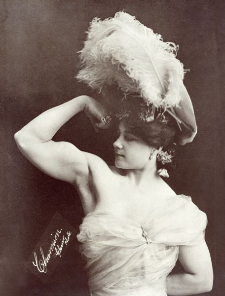 "Charmion (1875-1949, born Laverie Cooper in Sacramento) was a vaudeville trapeze artist and strongwoman who performed a trapeze striptease in 1897 that made her famous. Her performance was recorded in an Edison Company silent film ""Trapeze Disrobing Act"" in 1901.  <i>New York Times,</i> 12 December 1897: ""Laveria Charmion, a female trapese performer, who will appear at Koster & Bial's this week, appears on the stage and ascends to her bar in midair in what seems to be street costume. While on the bar she gradually discards her superfluous apparel. This is accounted a 'sensational' turn."""