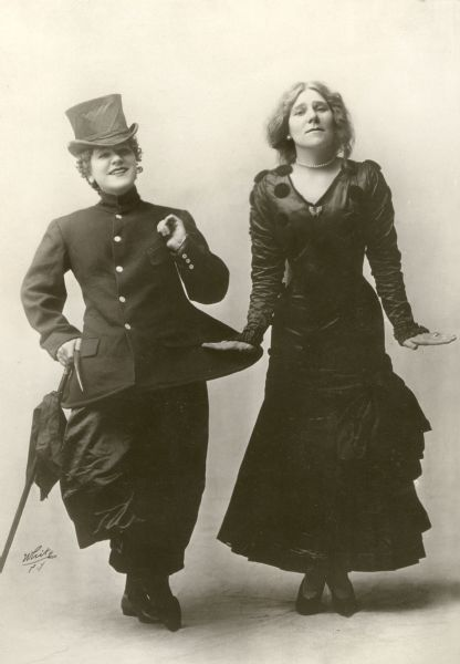 Mazie Trumbull, famous as a cross-dresser and dancer, and her sister Frances, side by side in a White Studio photograph.