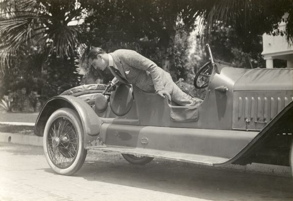 Norman Kerry in a Roadster | Photograph | Wisconsin Historical Society