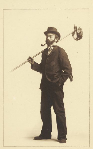 Albert Hansen, member of the Menomonie High School class of 1905, depicting himself as a hobo, with a pipe and a handkerchief. Part of a yearbook he created, based on a class prophecy theme.