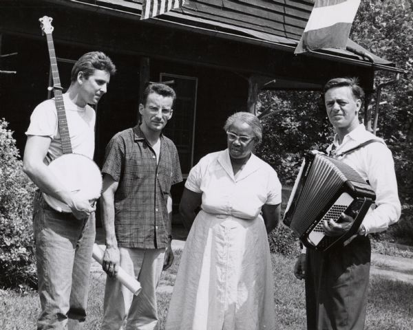 A meeting at Highlander Folk School. Guy Carawan is holding a banjo on far left.  Septima Clark standing third from the left. Matt Sturgis standing extreme right.