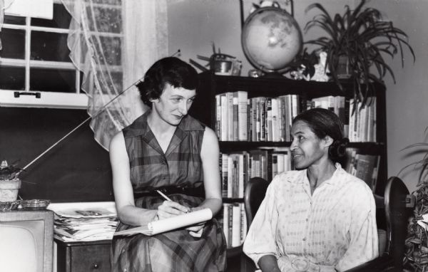 "Rosa Parks being interviewed by Mrs. Anne Braden, editor of the ""Southern Patriot,"" at Braden's home."