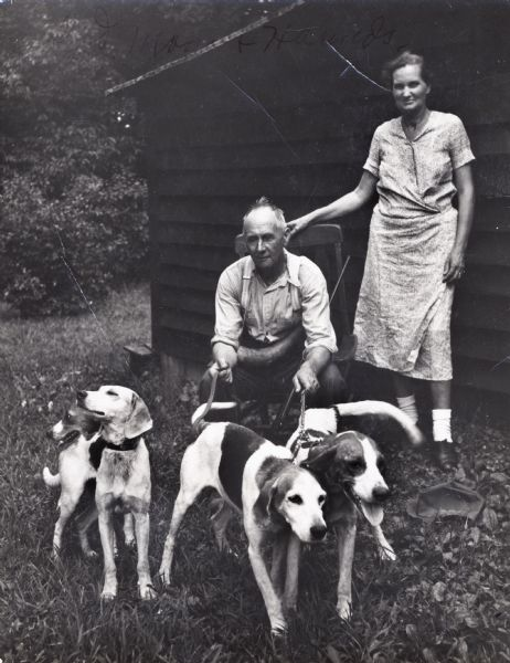 Perry and Elsie Horton, parents of Myles Horton, with fox hounds, at Highlander Folk School.