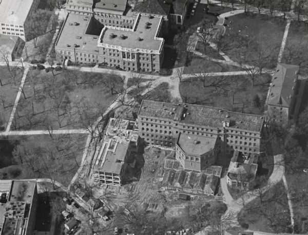 Aerial view of Birge and Bascom Halls (formerly Main Hall) on the University of Wisconsin-Madison campus.  Birge Hall (foreground) with addition under construction.  Bascom Hall is at the top of the image.