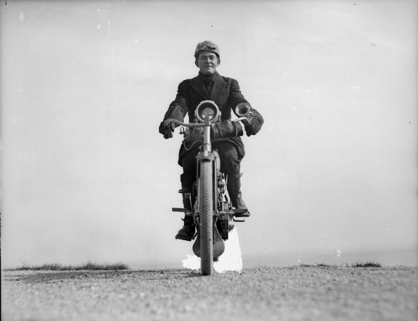 Front view of the photographer J. Robert Taylor on his motorcycle.