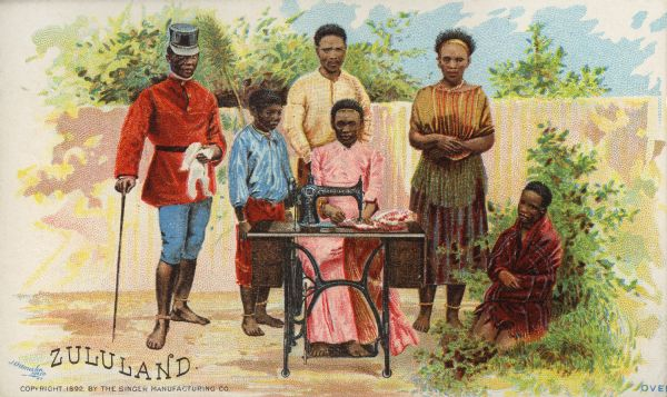 "Chromolithograph card of a group of people from ""Zululand"" in ""native"" costume, posing next to a Singer sewing machine. Part of a ""Costumes of All Nations,"" set created as a souvenir at the 1893 World's Columbian Exposition."
