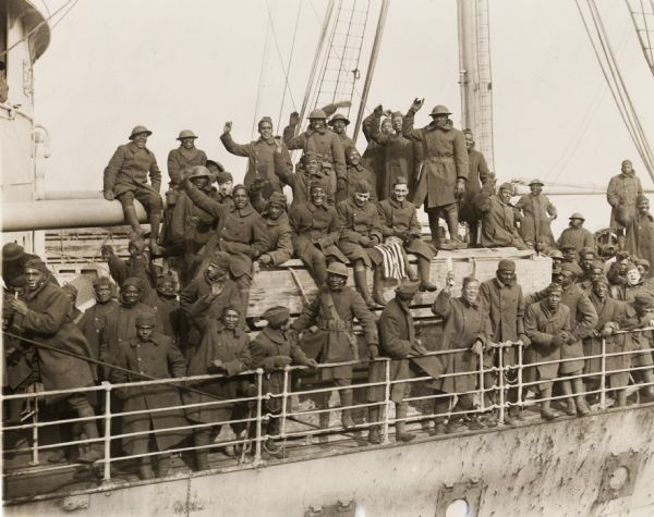 Members of the 15th Regiment (Colored) of the New York National Guard arrive home as heroes. They earned the distinction of being the only regiment to never have a man captured or lose a foot of ground or trench.