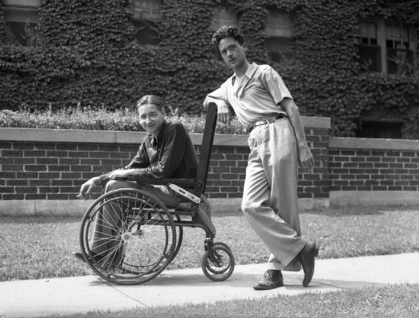 "Humorous photograph taken on Maryland Avenue of Bloch in his father's wheelchair, being pushed by Henry Kuttner (agent), during a visit from Los Angeles. Bloch's father died of a ""wasting"" illness."