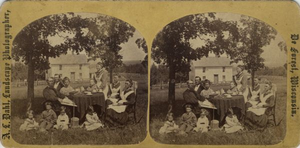"Stereograph of Rev. A. Jacobson, family and visitors, Perry, Wis."" from Dahl's 1877 ""Catalogue of Stereoscopic Views."" Jacobson (1836-1910) immigrated to the United States in 1848. He married Nicoline Hegg in 1863."