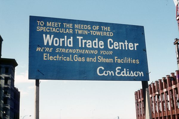 "Con Edison billboard for the World Trade Center. The sign reads ""To meet the needs of the spectacular twin-towered World Trade Center we're strengthening your Electrical, Gas and steam facilities Con Edison""."