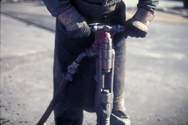 Close-up view of jackhammer operator during the construction of the World Trade Center.