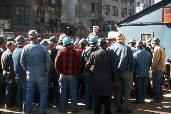 Construction workers gather to meet near the office for the Sand Chapter of Mechanical Contractors before beginning work during the construction of the World Trade Center.