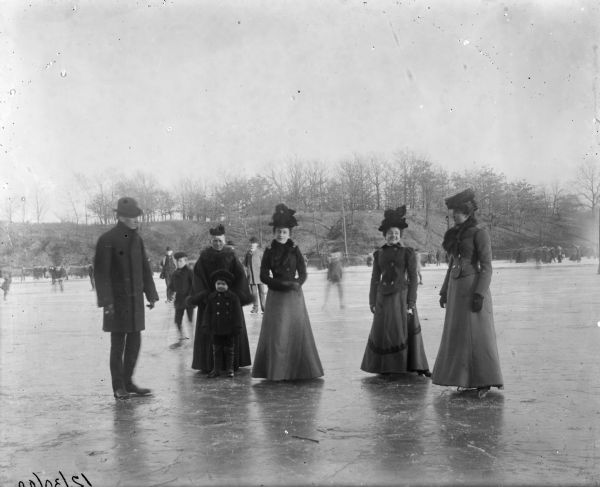 "Winter scene with four women, a man and a child, all well-dressed, posing on the ice wearing ice skates. Other skaters are behind them. Caption reads: ""Syl, Grandma, and others posing on skates.""<p>The boy is Harry Sylvester Dankoler (1895-1908) standing in front of his grandmother Matilde (Wahe/Wehl) Dankoler/Damkoehler (1832-1918).</p>"