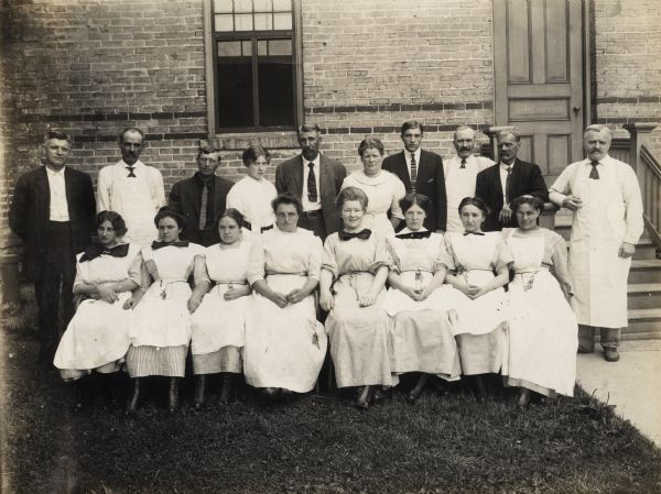 Group portrait outdoors of the administrative and nursing staff of the Winnebago County Asylum. Pictured in the center back row is E.E. Manuel, the Superintendent. To the right of E.E. Manuel is his wife, Olphene (Stromme) Manuel, the Matron of the Asylum. And to the left of him is his daughter, Bessie L. Manuel, who served as the bookkeeper at the Winnebago County Asylum and Poor Farm.