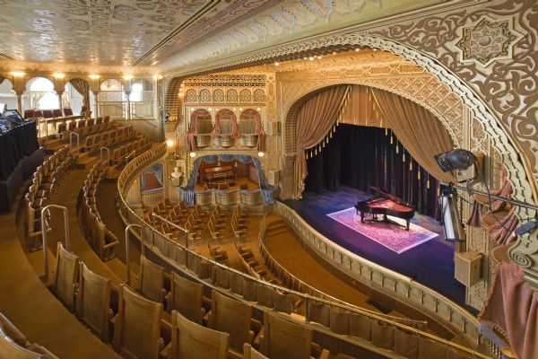 Interior view of Mabel Tainter Memorial Theater from balcony with view of stage and organ.