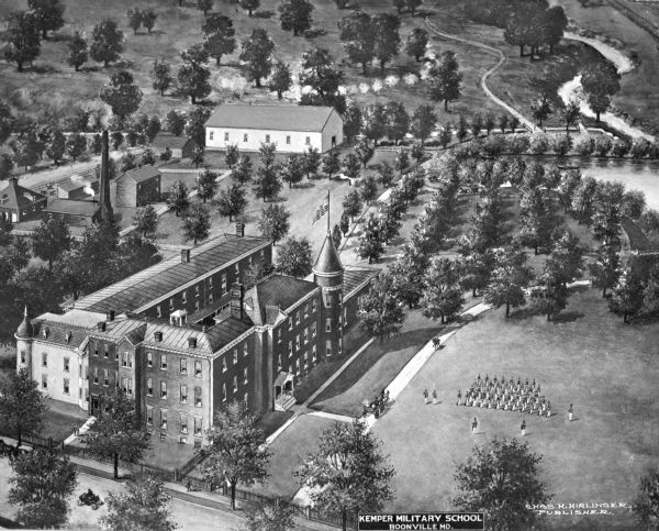 An aerial view of Kemper Military School.   A formation of soldiers march in a field and  a school building can be seen on the left.  Published by Chas H. Hirlinger.