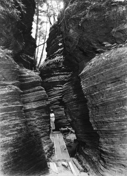 View of a woman standing at Cold Water Canyon, a rock formation near the Wisconsin River.