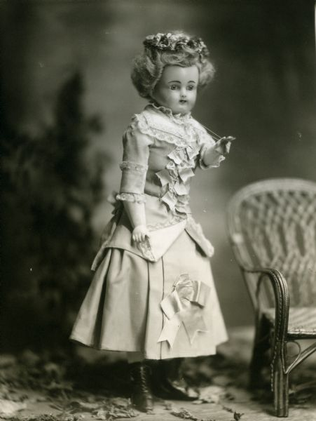 "A portrait of the doll, Violet, from the collection of the photographer's wife, Alice Kent Trimpey. The doll has a wax-over-composition head and is described on the negative jacket as having been ""made in a Paris shop."""