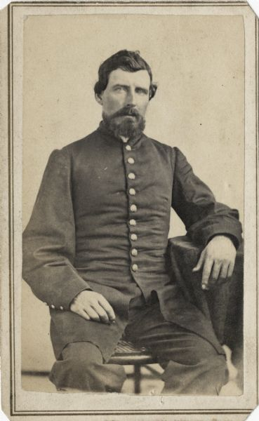 Seated carte-de-visite portrait of Captain Lewis Jones from Company E of the 4th Wisconsin Cavalry.