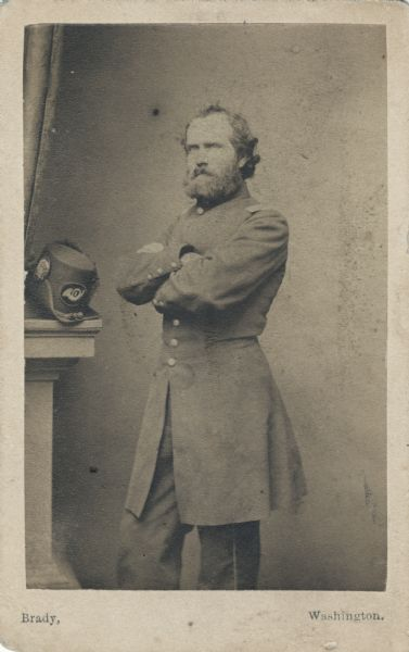 "Three-quarter length carte-de-visite portrait of Captain Nathaniel Rollins, Company H, 2nd Wisconsin Infantry (""Iron Brigade"")."