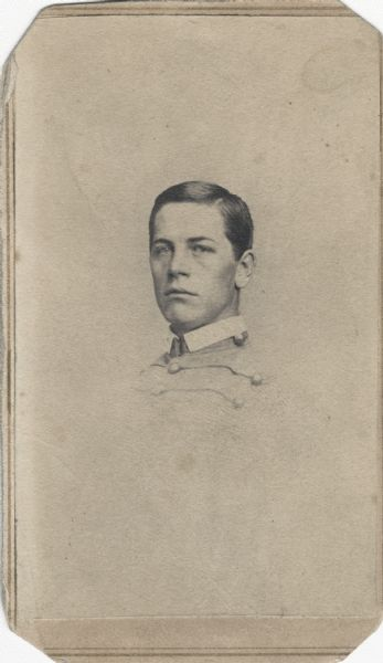 Vignetted carte-de-visite portrait of Corporal William H. Upham, Company H, 2nd Wisconsin Infantry, in a cadet uniform.