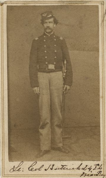 Full-length carte-de-visite portrait of Lieutenant Colonel Edwin L. Buttrick, 24th Wisconsin Infantry, standing in full uniform with sword on left side.