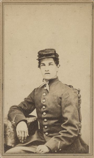 Seated carte-de-visite portrait of James D. Butler, Jr., Company F, 44th Wisconsin Infantry, in his uniform.