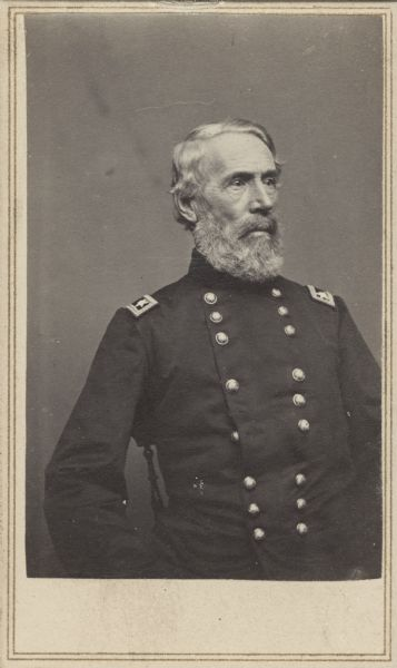 Seated, waist-up carte-de-visite portrait of Major General Edwin Vose Sumner wearing officer dress uniform. At the start of the Civil War President Lincoln promoted him to Brigadier General and assigned him to the command of the Department of the Pacific. In March 1862 he was attached to the Army of the Potomac, seeing fighting during the Peninsular Campaign. For his actions during the campaign he was appointed to Major General of volunteers. Before he relieved himself of command, he also fought in the Battles of Antietam and Fredericksburg.