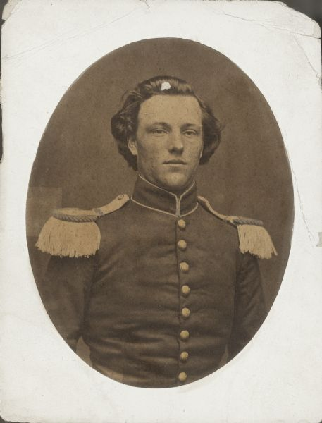 Waist-up oval portrait of Cary M. Campbell, Company K, 1st Wisconsin Infantry, in uniform with epaulettes. He enlisted for a three-month term of service at Madison, Wisconsin on April 17, 1864 and was mustered out of service on August 21, 1861.