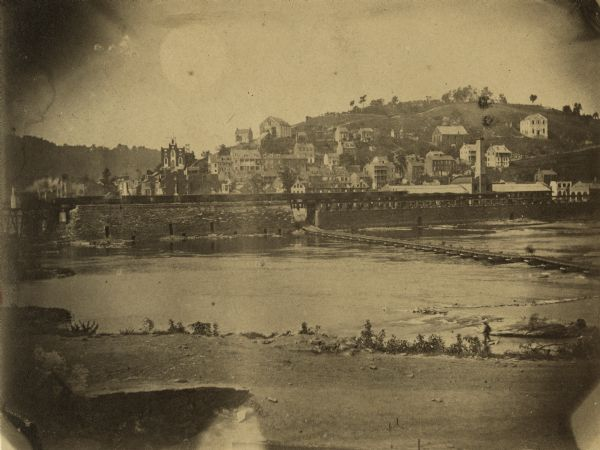 View of Harper's Ferry, showing the pontoon bridge and bridge (extreme left) which was destroyed in 1861.