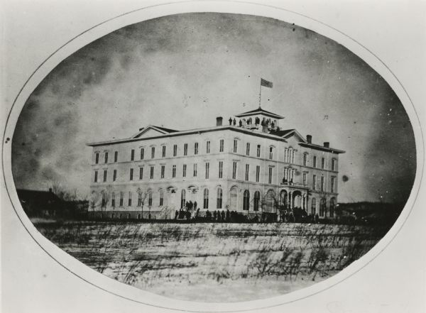 Union troops at Lawler Hall which was used as a U.S. military hospital during the Civil War. Originally built as the Brisbois Hotel in 1857, it was given for use as a beginning for a College of Prairie du Chien, which failed. It would later go on to become a Companion College in 1880. Finally in 1955, the building was abandoned as unsafe.