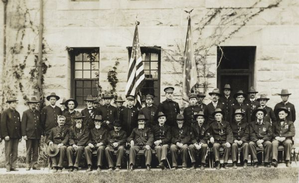 Group portrait outdoors of a group of Civil War veterans with other U.S. military officers.