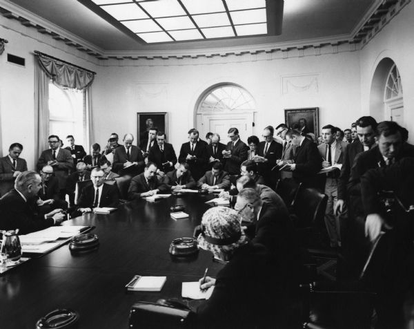 President Lyndon Johnson meets with the press in the Cabinet meeting room.