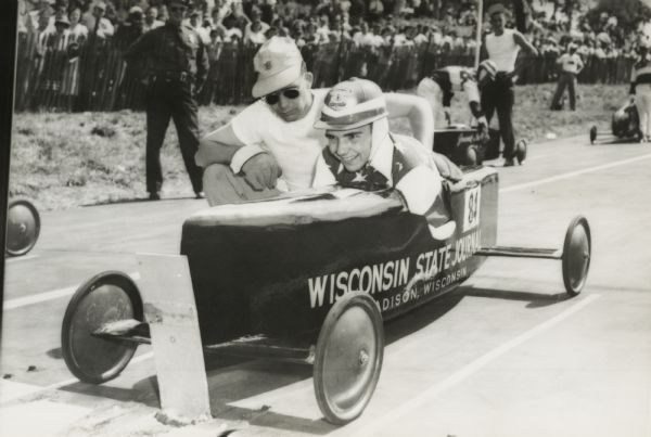 Madison, Wisconsin Champion Roddy Botts with a volunteer at the starting line of the All-American Soap Box Derby at Derby Downs.