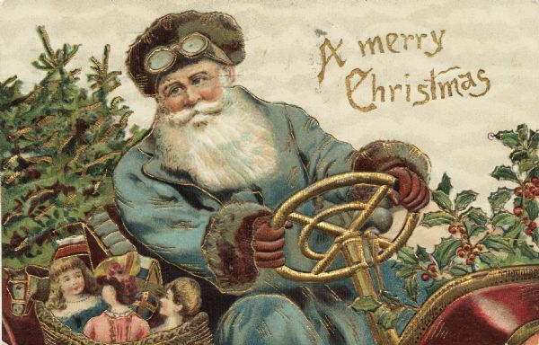 Holiday postcard showing Santa Claus behind the steering wheel of his motorized sleigh. Holly fills the front and pine boughs fill the back. He is wearing a driving hat and goggles. His coat is light blue and his gloves are brown. He has a basket full of toys next to him. Chromolithograph. Entire image is embossed.