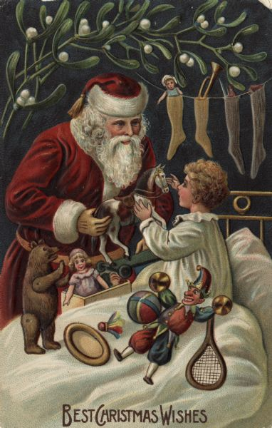 "Holiday postcard with Santa Claus at the bedside of a child, handing out toys. There are dolls, a bear, a badminton racket and bird, ball and a toy horse. Santa Claus is wearing the traditional red suit and hat trimmed with white fur. There are stockings filled with toys, dolls and a horn on a line hanging over the headboard. Mistletoe decorates the top of the card. Text at foot reads: ""Best Christmas Wishes"". Chromolithograph and embossed. Printed in Germany."