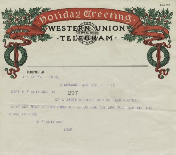 "Holiday telegram from Western Union Telegram and Cable. The telegram form has a holiday theme. At the top is a banner with the text ""Holiday Greeting"" and wreaths and holly on each side. The message is ""Love and best wishes from all of us for the New Year and all the years to come."" Letterpress."