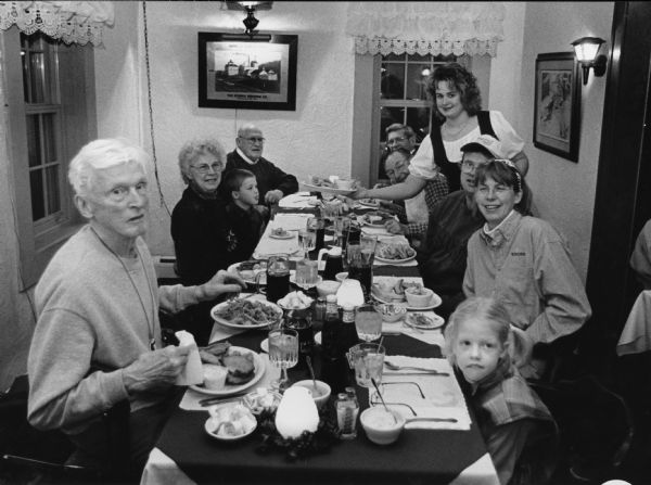 """Vicki, waits on our group at the Little Red Inn in St. Lawrence."" Pictured (Clockwise around the table); Ralph Widmer, Shirley Widmer, Parker Hren, John Bodden, Ralph ""Buddy"" Ruecker, Rudy Heinecke, Vicki, Larry Hren, Kay Hren, and Carly Hren."