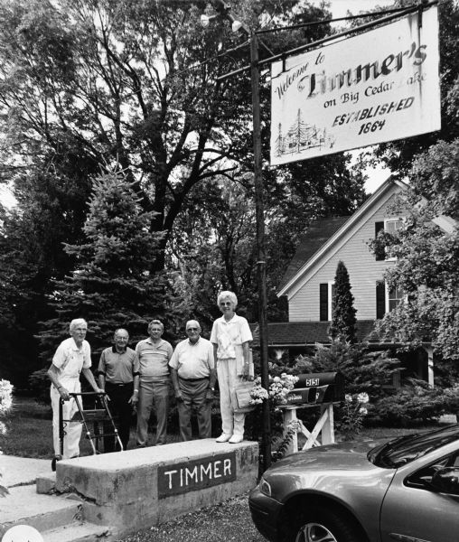 """Timmer's is on the southeast shore of Big Cedar Lake in Washington County. In the past it served as a hotel dating back to 1864."" From left to right; Ralph Widmer, Rudy Heinecke, Ralph ""Buddy"" Ruecker, John Bodden, and Shirley Widmer."