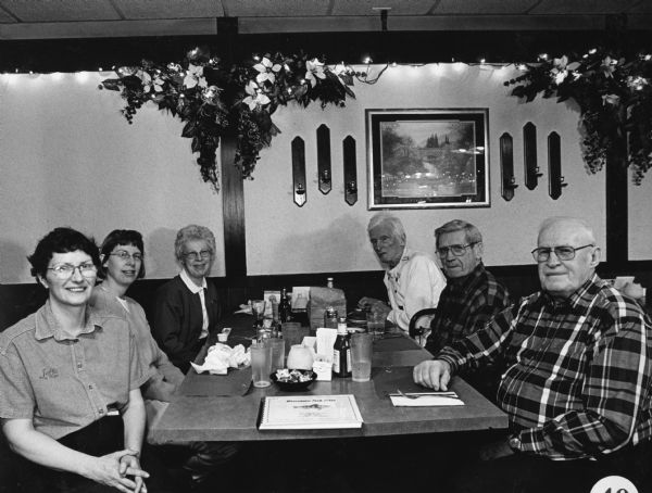 """Eve, is our waitress at Jeff's on Rugby in Oshkosh."" Note the book at the head of the table. It is volume C of the fish fry collection."