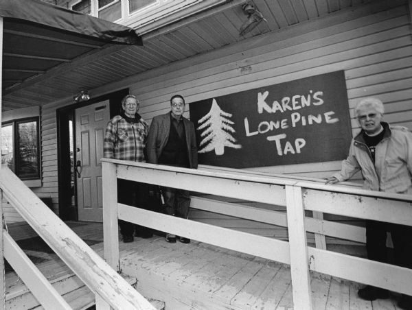 """Today we reach a new milestone with our 400th different restaurant. We are at Karen's Lone Pine Tap on Historical Lake Sinissippi. There address is N4571 Highway E, 1/2 mile North of Hustisford."" From left to right; Ralph ""Buddy"" Ruecker, John P. Widmer, and Shirley Widmer."