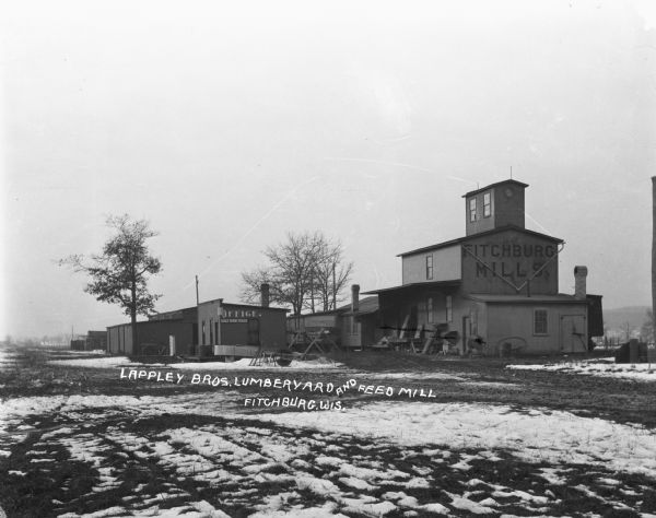 Winter view of exterior of Lappley Bros. Lumberyard and Feed Mill.