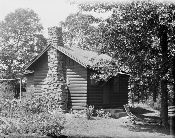 Cabin with a stone chimney at the Birchcliff Hotel.